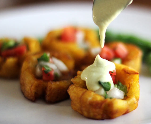 Fried Plantains - Tostones with pico de gallo and Hatch chile sauce