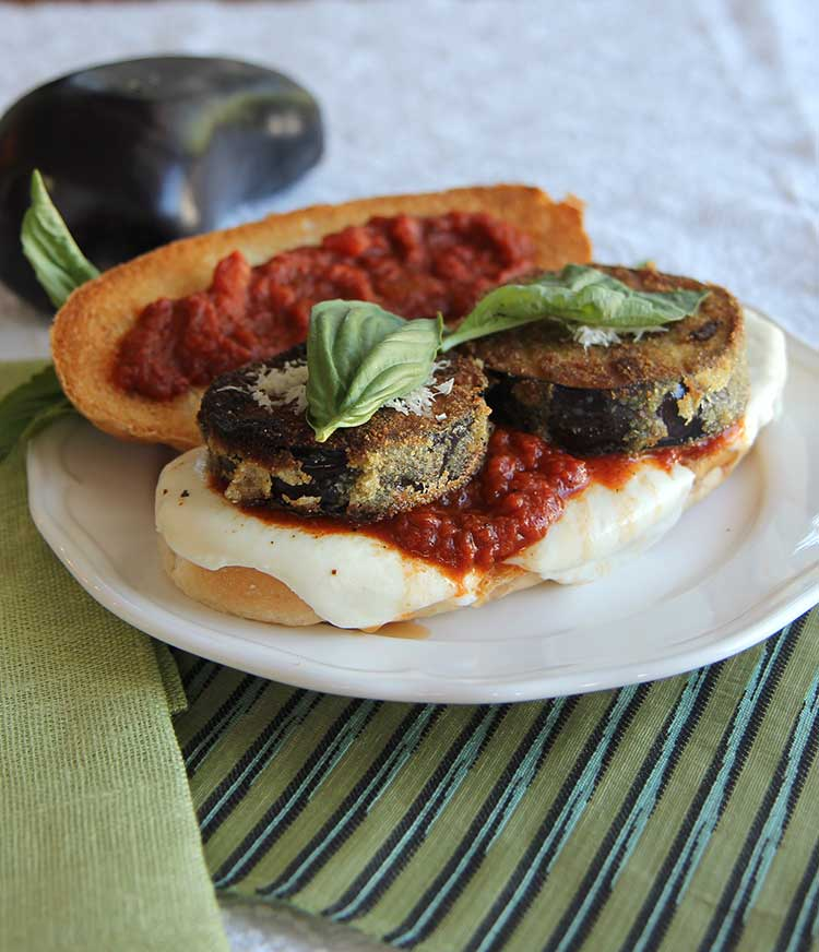Eggplant parmesan sandwiches! Crispy fried eggplant Parmesan with melted mozzarella, fresh basil and marinara sauce. This is one of my favorite summer sandwiches