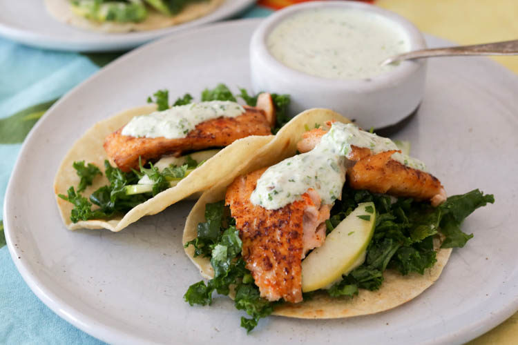 Fresh salmon tacos with kale slaw and creamy jalapeño salsa