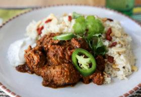 Easy lamb curry, reminiscent of lamb vindaloo. Lamb stew flavored with onion, garlic, ginger, mustard seeds, coriander and garam masala