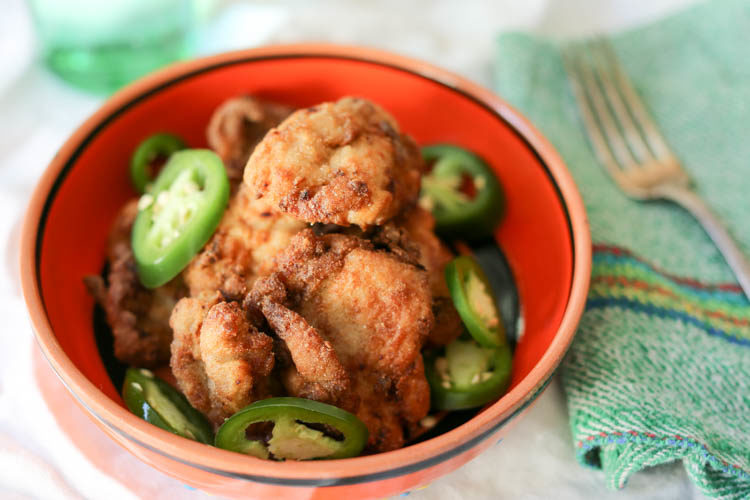 Jalapeño fried chicken! Boneless chicken marinated in pickled jalapeño brine, breaded with masa harina and fried crispy