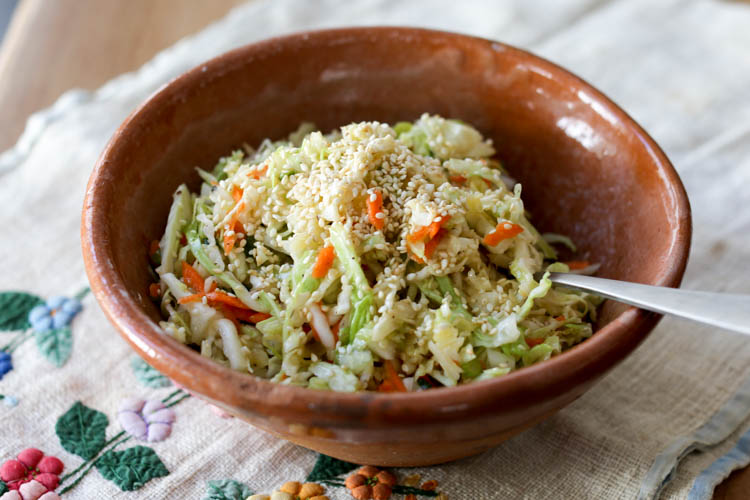 A simple, sweet and sour sesame coleslaw. This no-mayo slaw is similar to the Salt Lick recipe but a little easier to make at home