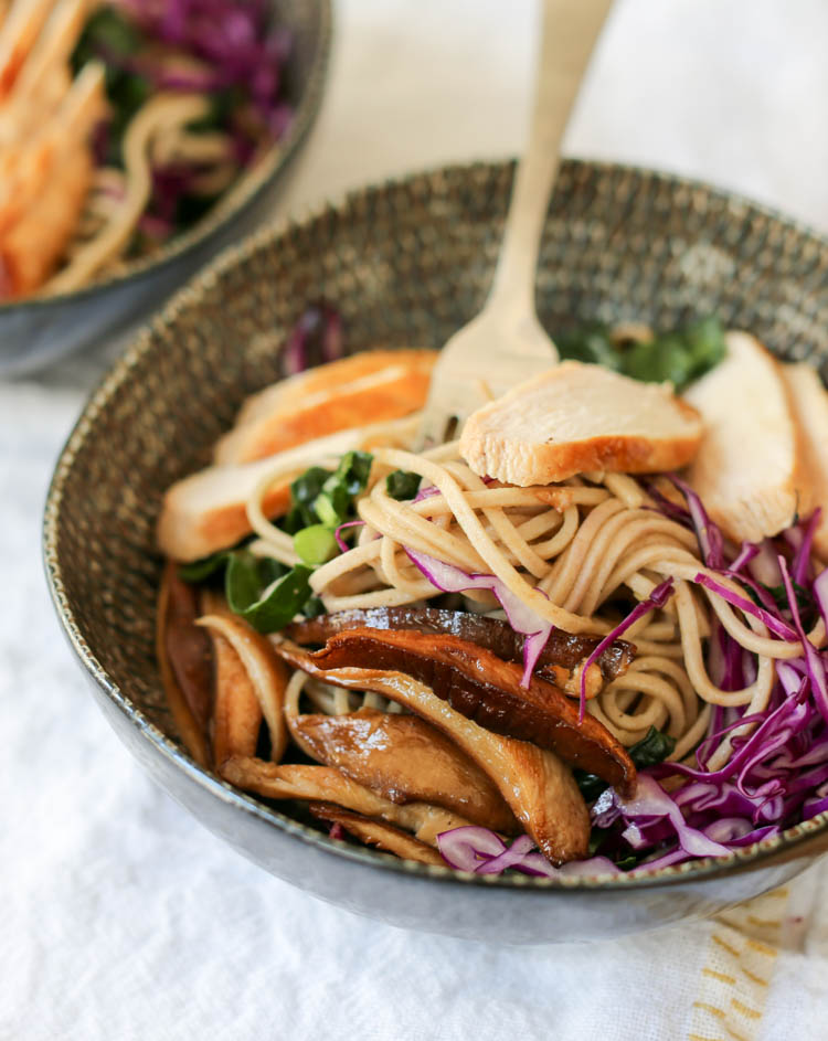 Heathy soba noodle salad bowl with pickled shiitake mushrooms, kale and a soy-ginger vinaigrette. Use chicken or tofu to make it vegan