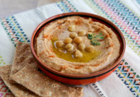 Slightly spicy, smoky chipotle hummus recipe with garlic, lime and chipotle en adobo