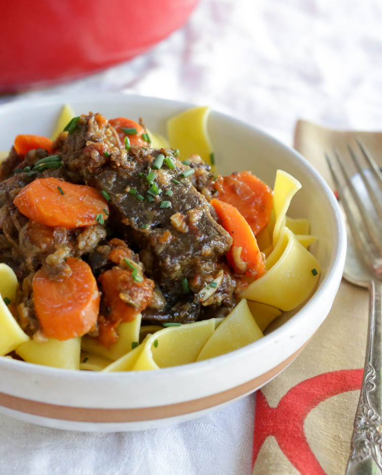 Daube de Boeuf - a dead-simple French beef stew with carrots, mushrooms, cooked down with vermouth and gin. Sounds weird as hell, but your guests will love it