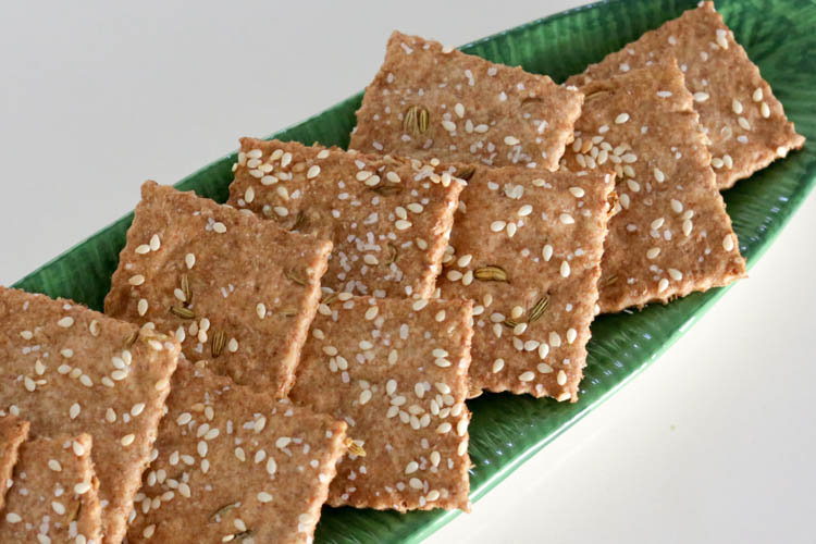 Simple, easy cracker recipe made with whole wheat flour, sesame seeds. This cracker recipe has only 5 ingredients and tastes very similar to ak-mak brand sesame crackers! Add fennel seed, caraway seed, cumin or celery seeds to customize your healthy homemade crackers
