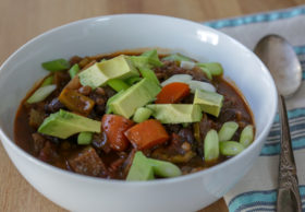 Easy vegetable chili with black beans, lentils, carrots and chayote. This vegan chili will warm your butt