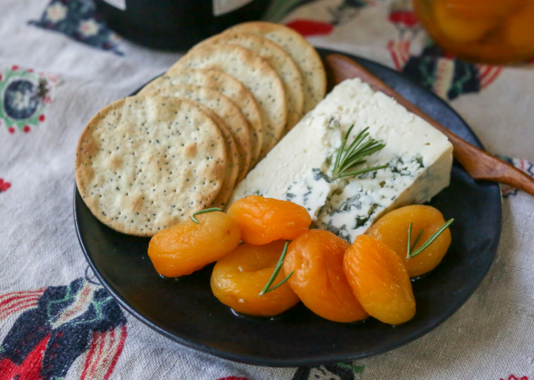 Rosemary-honey marinated dried apricots are a unique, delicious and easy addition to a holiday cheese plate!