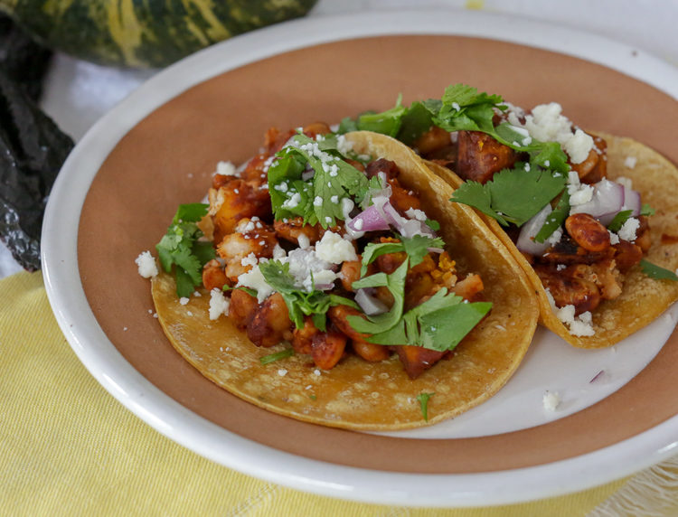 Easy vegan or vegetarian tacos with white beans, pumpkin, and ancho chile salsa. Pumpkin tacos are perfect for meal prepping and Meatless Mondays