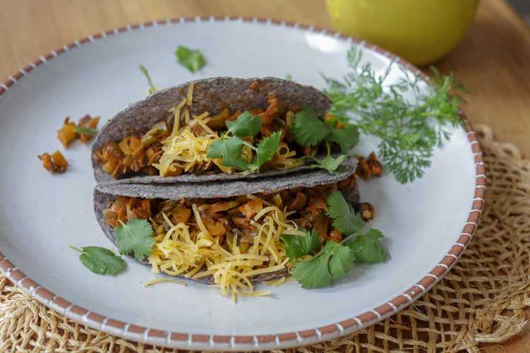 Vegan crispy taco filling with no beans! Mushrooms, vegetables, spices, and some walnuts or pecans for healthy fats and great texture. Serve this vegan picadillo inside crispy taco shells or soft tortillas with your choice of toppings. Also great as a taco salad!