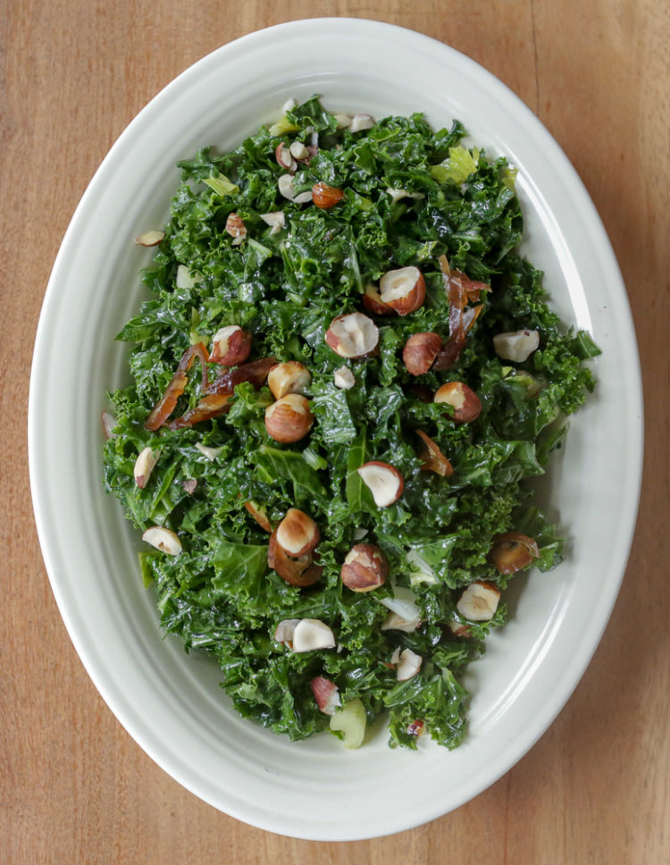 Date and kale salad: massaged kale salad with olive oil, lemon juice, pomegranate molasses, dates, celery, nuts and a bit of hot peppers