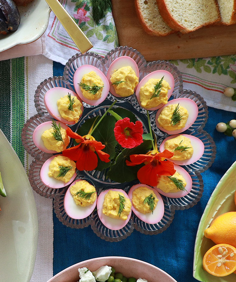 Pickled pink deviled eggs for Easter. Soaking your peeled, boiled eggs in pickled beet juice before deviling them results in beautiful colorful deviled eggs