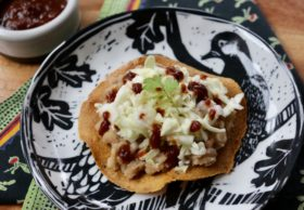 baked tostadas with refried beans and cabbage