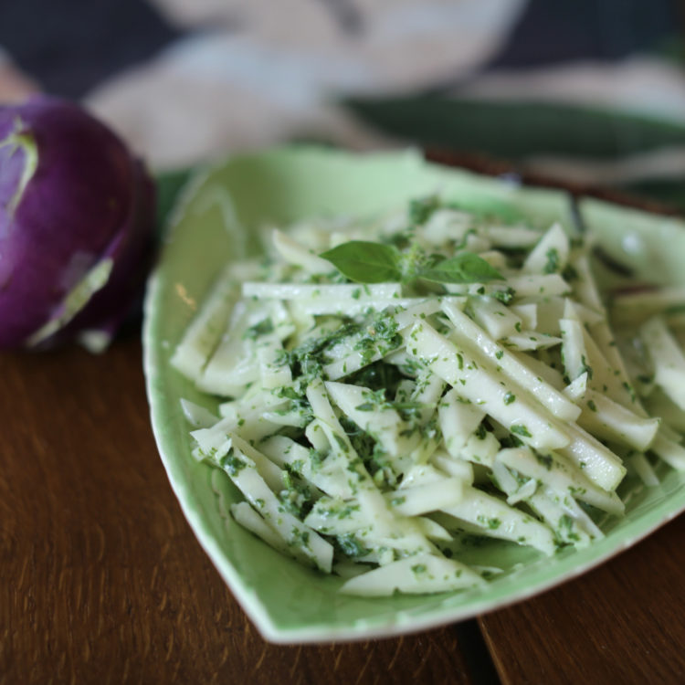 Kohlrabi slaw with herbed green goddess dressing in a green dish