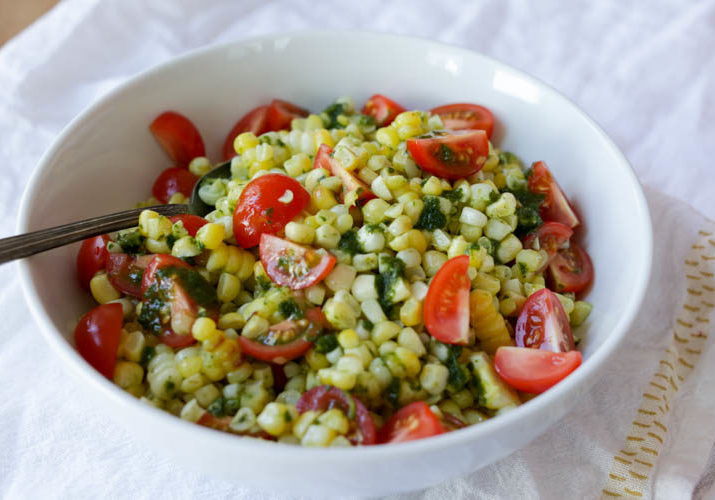 Summer corn salad with basil oil and cherry tomatoes