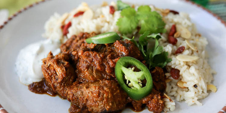 Easy lamb curry, reminiscent of lamb vindaloo. Lamb stew flavored with onion, garlic, ginger, mustard seeds, coriander and garam masala