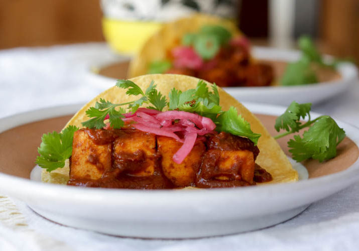 Tofu Mole Tacos! Fried tofu cubes simmered in a homemade vegan mole sauce made with dried chiles, tomatoes, garlic, spices, and sesame seeds