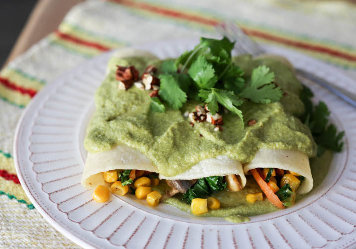 Vegan Enchiladas with Creamy Green Sauce. Vegetable enchiladas filled with carrots, corn, kale and mushrooms. Creamy vegan sauce made of cashews and roasted poblano peppers